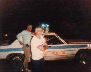 Robert and Barry with Chicago Police patrol car